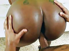 Booty ebony chick get a white dick on a white sofa